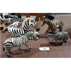 FOUR ZEBRA FIGURES