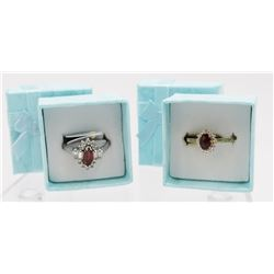 TWO RUBY COLORED STERLING SILVER RINGS