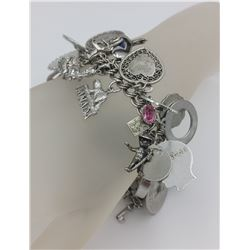 STERLING SILVER CHARM BRACELET WITH OVER 40 CHARMS