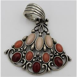 CAROLYN POLLACK PENDANT. PINK, ORANGE AND RED STONES.