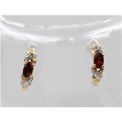 DIAMOND AND RUBY GOLD TONED STERLING SILVER EARRINGS.