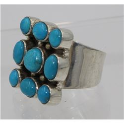 STERLING SILVER RING WITH 9 TURQUOISE STONES