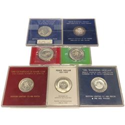 WORLDWIDE: LOT of 7 counterstamped modern coins
