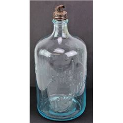 Early glass water bottle embossed International