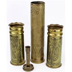 Collection of 4 brass cartridge trench art