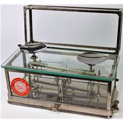 Glass and nickel cased balance scale