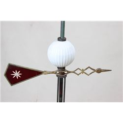 Antique weather vane with white glass