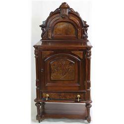 C. 1870's walnut single door cabinet