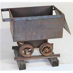 Miniature metal mining ore car about half scale