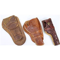 Collection of 3 leather holsters