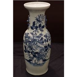 "A celadon-glazed blue-and-white ""birds and flowers"" vase with two ears."