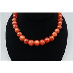 A 32-Bead Old Nanjiang Red Agate.