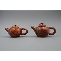 A Pair of Small Huanghuali Teapot Hand Pieces.