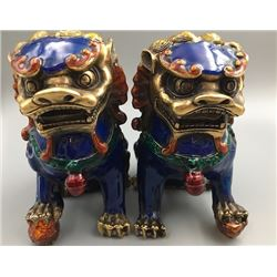 A Pair of Two Middle 20th Century Cloisonne Enamel Lions.