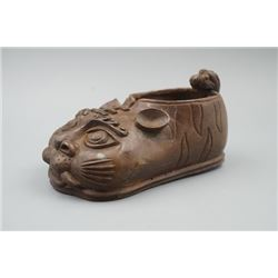 "An Old Bronze Shoe Decoration in a ""Tiger"" Shape."