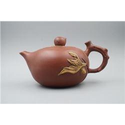 """A """"Yi Xing Tang Du Tao Ye Sheng Chan He Zuo She Chu Pin"""" Mark Yixing Teapot."""