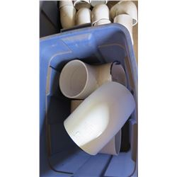 "Contents of Tub: 6"" White PVC Elbows"