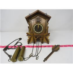 CUCKOO CLOCK W/ WEIGHTS FROM GERMANY, *NO FINIALS, KEEPS GOOD TIME*