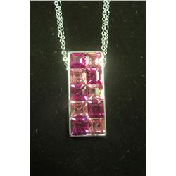 Rectangular silver pendant with a double row of fushia and light rose swarovski crystals on a double