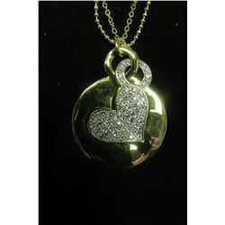 "Gold framed Swarovski crystal heart pendant layered over round heart pendant on 28"" necklace"