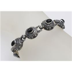 "INDONESIA STERLING SILVER AND ONYX BRACELET INDONESIA STERLING SILVER AND ONYX BRACELET. 7"" LONG. CL"