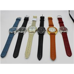 LOT OF 6 QVC DESIGNER WATCHES LOT OF 6 QVC DESIGNER WATCHES - NEVER WORK BUT WILL NEED BATTERIES. IS