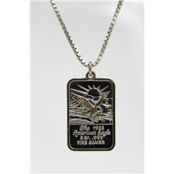 ".999 5 GR. SILVER BAR ON A STERLING SILVER CHAIN .999 5 GR. SILVER BAR ""THE 1983 AMERICAN EAGLE"" STA"