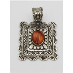 GORGEOUS RELIOS TRADEMARK PENDANT GORGEOUS RELIOS TRADEMARK PENDANT WITH ORANGE STONE. 18.6 GRAMS. P