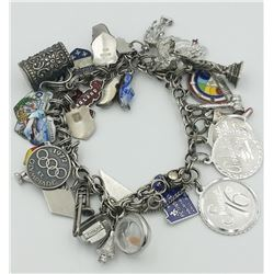 STERLING SILVER CHARM BRACELET STERLING SILVER CHARM BRACELET WITH OVER 25 CHARMS! PRE-OWNED. 75.6 G