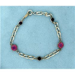7 inch Sterling Silver Avon Bracelet with Pink and Purple Crystal Stones