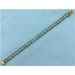 13 ct Blue Topaz Bracelet in 14k Yellow Gold
