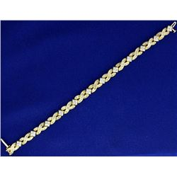 3 ct TW Diamond Tennis Bracelet with Baguette and Round Diamonds IN 14K Yellow and White Gold