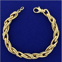 Heavy Italian Made Designer Twisting Link Bracelet in 14K Yellow Gold