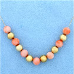 Pink Coral and Gold Ball Necklace in 14K Yellow Gold.