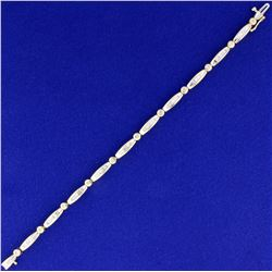 1ct TW Round and Baguette Diamond Tennis Bracelet in 14k Yellow Gold