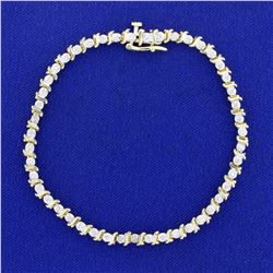 1/4ct TW Diamond Tennis Bracelet in 10K Yellow and White Gold