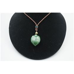 "A Canada Jade ""I Love You"" Heart Shape Pendant with String Necklace."