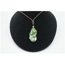 """A Canada Jade """"Peach"""" Pattern Pendant with String Necklace.."""