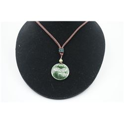"""A Canada Jade """"Bat"""" Pattern Pendant with String Necklace."""
