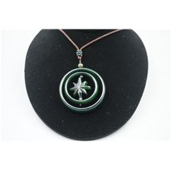 "A Canada Jade Double Circle ""Floral"" Shape Pendant with String Necklace."