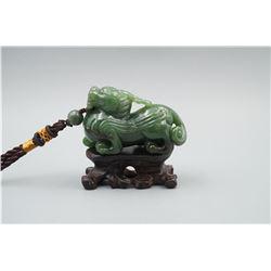 "A Canada Jade ""Auspicious Beast"" Pattern Hand Piece."