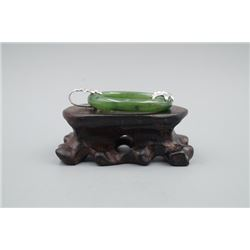 A Canada Jade Ring Pendant Inlaid with a 925 Silver Leaf.