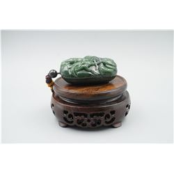 """A Canada Jade """"Dragon and Cloud"""" Pattern Hand Piece."""