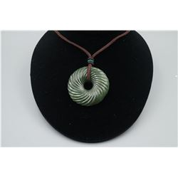 "A ""Spiral"" Pattern Peace Buckle Pendant with String Necklace."