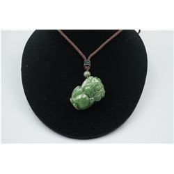 """A Canada Jade """"Auspicious Beast"""" Pendant with String Necklace."""