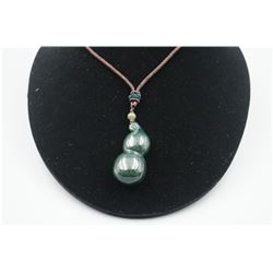 """A Canada Jade """"Calabash"""" Pattern Pendant with String Necklace."""