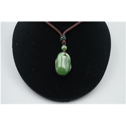 """A Canada Jade """"Bean Pod"""" Pattern Pendant with String Necklace."""