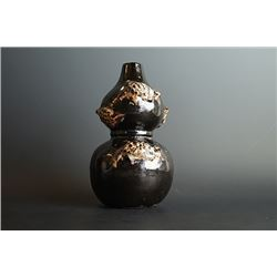A Mirror-Black Glazed Double-Gourd Vase with Relief.