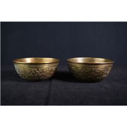 A Pair of Copper Bowls.