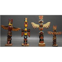 FOUR NORTH WEST COAST TOTEM POLES